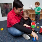 Preschool Teacher Caring for Young Students in our Papillion NE preschool building