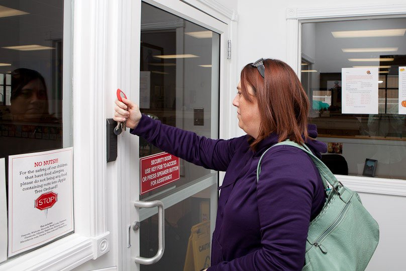 woman entering building with key fob
