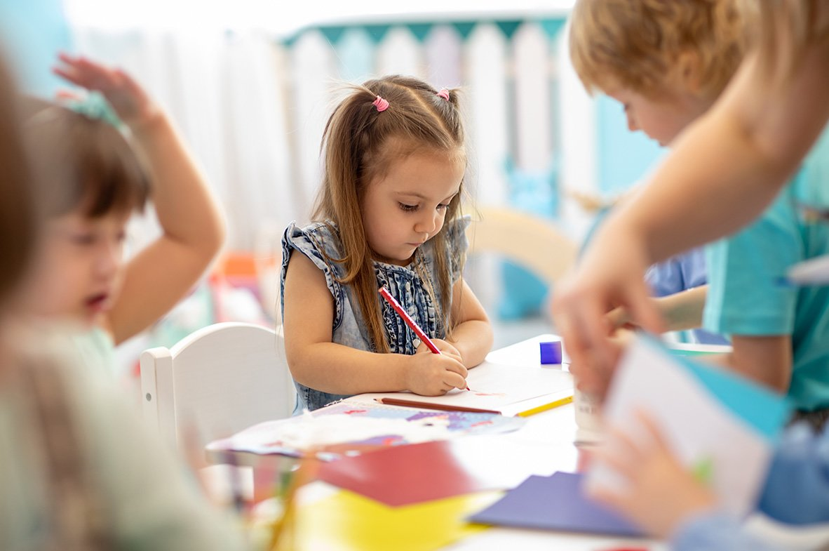 little girl coloring at preschool